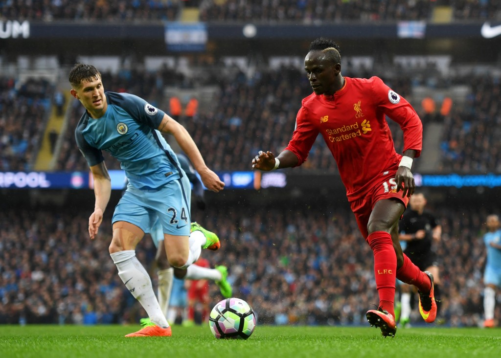 MANCHESTER, ENGLAND - MARCH 19: Sadio Mane of Liverpool (R) attempts to get past John Stones of Manchester City (L) during the Premier League match between Manchester City and Liverpool at Etihad Stadium on March 19, 2017 in Manchester, England.  (Photo by Michael Regan/Getty Images)