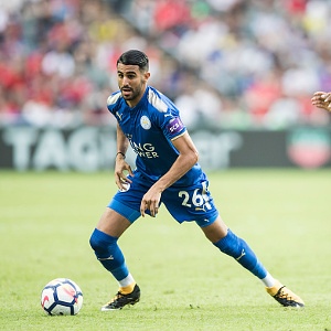 HONG KONG, HONG KONG - JULY 19: Leicester City FC midfielder Riyad Mahrez (L) fights for the ball with West Bromwich Albion defender Allan Nyom during the Premier League Asia Trophy match between Leicester City FC and West Bromwich Albion at Hong Kong Stadium on July 19, 2017 in Hong Kong, Hong Kong. (Photo by Power Sport Images/Getty Images)