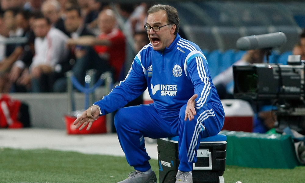 FILE - In this May 10, 2015 file photo, Marseille's coach Marcelo Bielsa, of Argentina, shouts instructions during a League One soccer match between Marseille and Monaco in Marseille, France.  In the latest controversy in his coaching career, Marcelo Bielsa quit as coach of Lazio on Friday, July 8, 2016, just two days after the Italian club announced it signed the former Argentina manager. (AP Photo/Claude Paris, FILE) ORG XMIT: LON116
